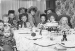 Bobby Stohl's second grade cowboy birthday party:  left to right around the table:  Alice Stohl, ?, Lee Norgard, ?,